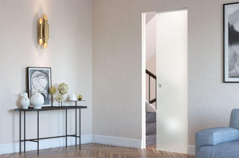 Porta-scorrevole-filo-muro-in-vetro